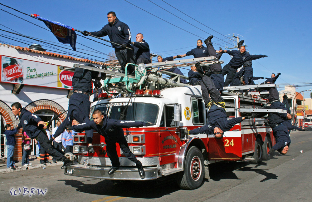 A group of Nogales, Sonora fire fighters perform in a parade. Do not try this at home.