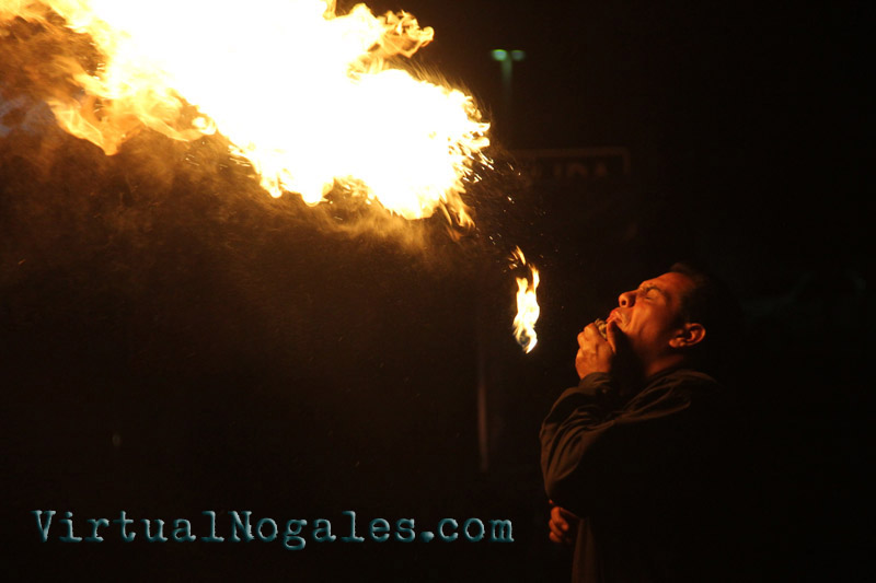 Blowing fire for tips on a Nogales, Sonora street intersection