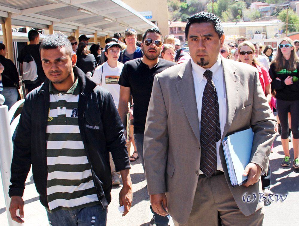 Ardani Rosales walks with his attorney as they prepare to cross the border